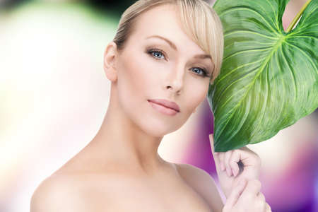 soft skin: picture of beautiful woman with green leaf   Stock Photo