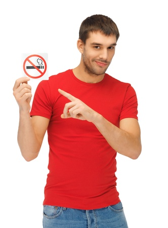 picture of serious man in red shirt with no smoking sign  photo