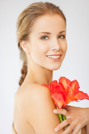 bright picture of lovely woman with lily flower Stock Photo - 15871901