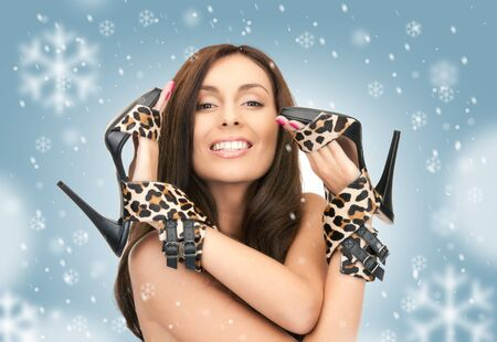 bright picture of lovely woman with leopard shoes over white  photo
