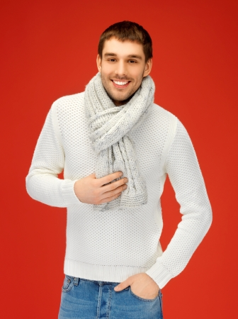 tog: bright picture of handsome man in warm sweater and scarf  Stock Photo
