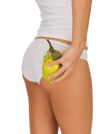 closeup picture of woman hands with yellow lemon photo