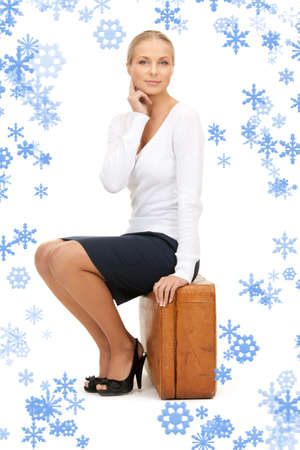business case: picture of beautiful woman with brown suitcase Stock Photo