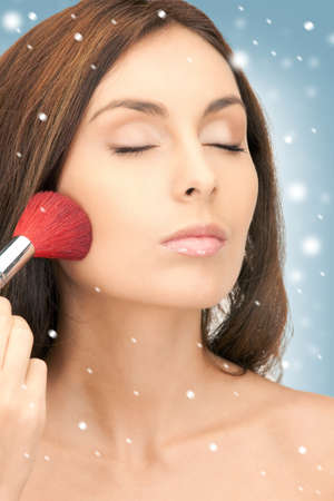 make up brush: picture of lovely woman with brush over white   Stock Photo