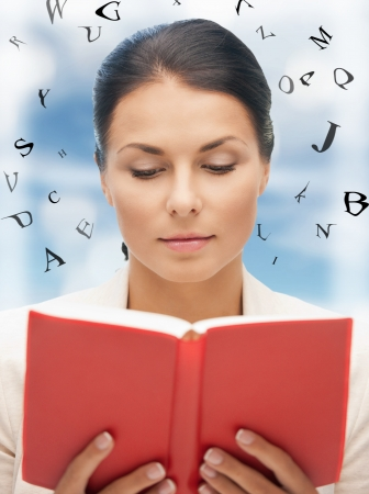 scholar: bright picture of calm and serious woman with book Stock Photo