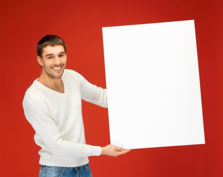 bright picture of handsome man with big blank board  photo