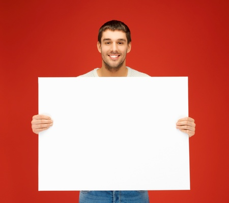 banner ads: bright picture of handsome man with big blank board  Stock Photo