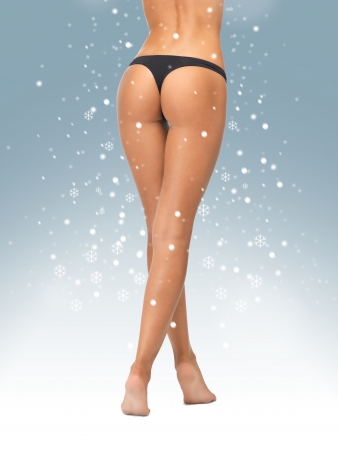 is slender: picture of female legs in black bikini panties Stock Photo