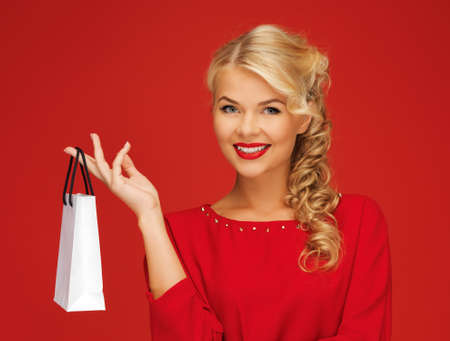 picture of lovely woman in red dress with shopping bag Stock Photo - 15977587