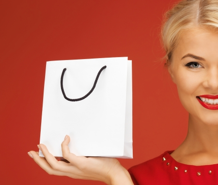 fancy bag: picture of lovely woman in red dress with shopping bag Stock Photo