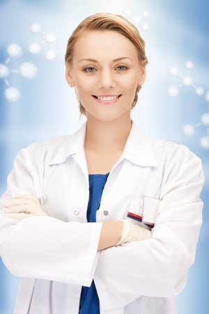 doctors smiling: bright picture of an attractive female doctor