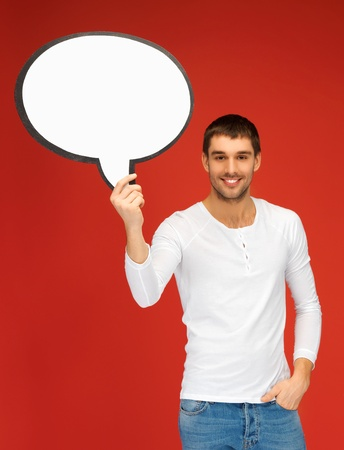 bright picture of smiling man with blank text bubble  photo