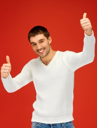 picture of man in warm sweater showing thumbs up  photo