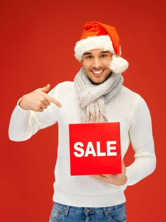 bright picture of handsome man in christmas hat Stock Photo - 16013734
