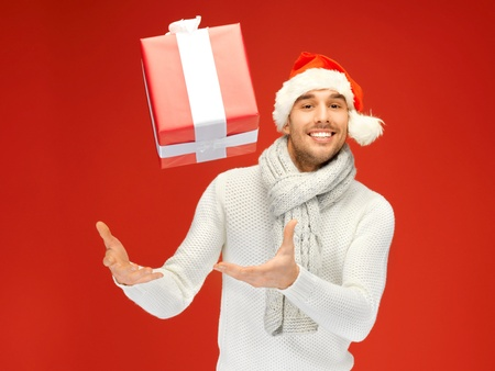bright picture of handsome man in christmas hat. photo