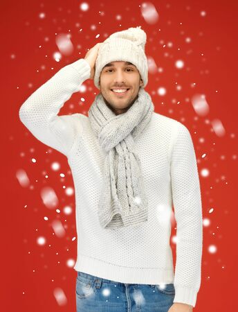 picture of handsome man in warm sweater, hat and scarf  Stock Photo - 16087299