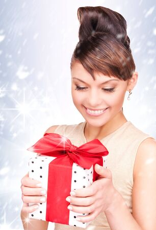happy woman with gift box over christmas lights photo