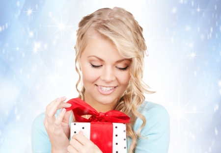 happy woman with gift box over christmas lights Stock Photo - 16064099