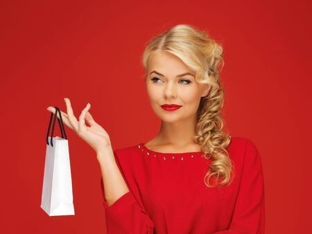 picture of lovely woman in red dress with shopping bag Stock Photo - 16084612