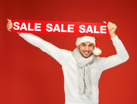 bright picture of handsome man in christmas hat  Stock Photo - 16084642