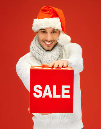bright picture of handsome man in christmas hat Stock Photo - 16084639