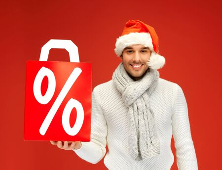 bright picture of handsome man in christmas hat   photo