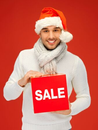 bright picture of handsome man in christmas hat Stock Photo - 16118124