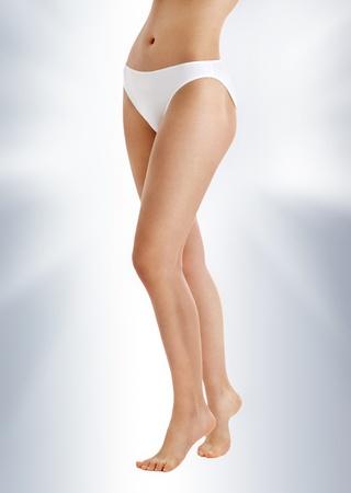 classical picture of long legs in white bikini panties photo
