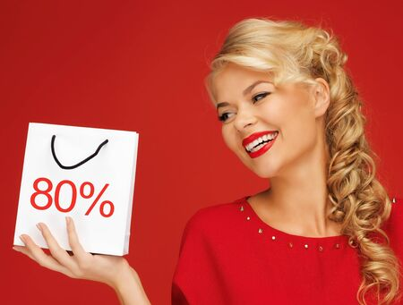 picture of lovely woman in red dress with shopping bag Stock Photo - 16142184