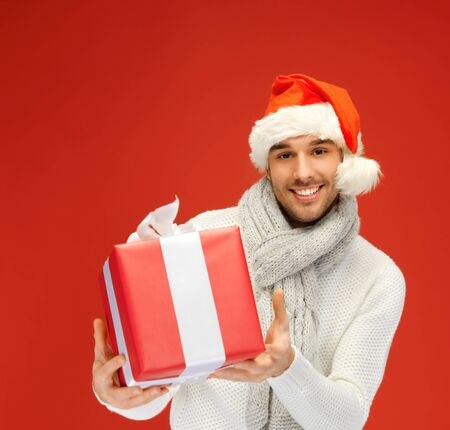 bright picture of handsome man in christmas hat Stock Photo - 16142121