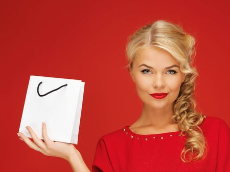 picture of lovely woman in red dress with shopping bag Stock Photo - 16142182