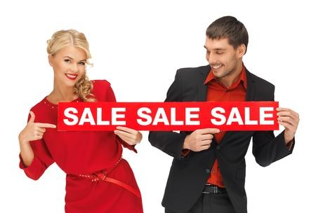 brillante imagen de hombre y mujer con la muestra de la venta