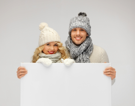 picture of family couple in a winter clothes holding blank board Stock Photo - 16142101
