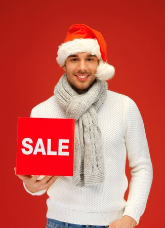 bright picture of handsome man in christmas hat Stock Photo - 16165295