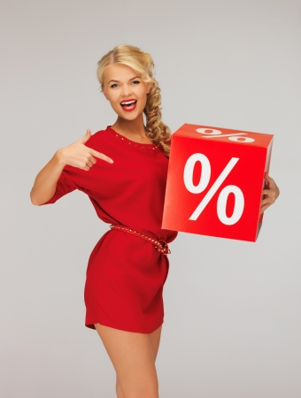 discounts: picture of lovely woman in red dress with percent sign Stock Photo