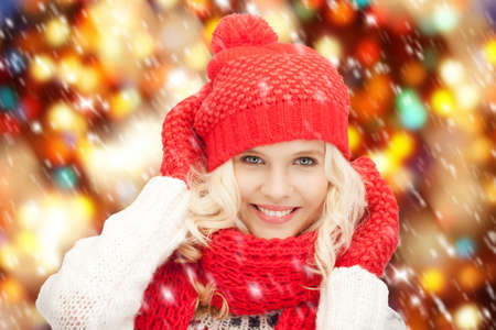 bright picture of beautiful woman in hat, muffler and mittens photo