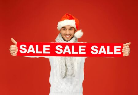 bright picture of handsome man in christmas hat Stock Photo - 16216066