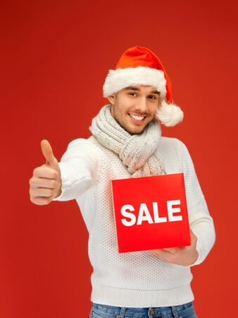 bright picture of handsome man in christmas hat Stock Photo - 16216087