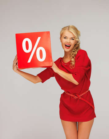 picture of lovely woman in red dress with percent sign Stock Photo - 16216047