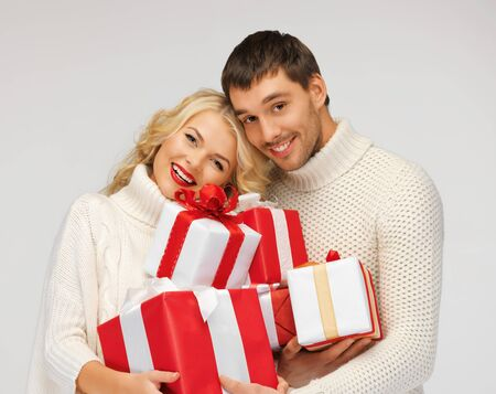 picture of romantic couple in a sweaters with gift boxes Stock Photo - 16216108