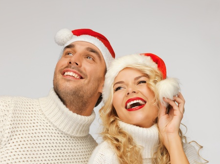 picture of family couple in sweaters and santa s hats Stock Photo - 16216109