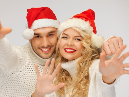 picture of family couple in sweaters and santa s hats Stock Photo - 16216120