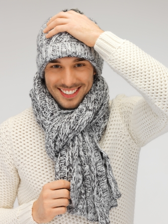 picture of handsome man in warm sweater, hat and scarf  Stock Photo
