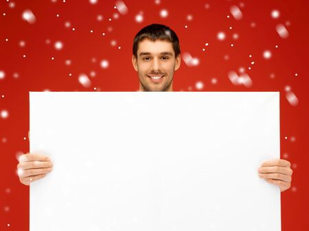 bright picture of handsome man with big blank board  Stock Photo - 16216081