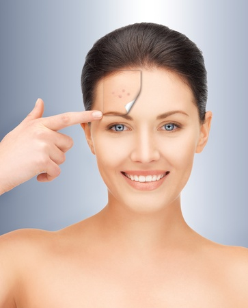 picture of beautiful woman pointing to forehead