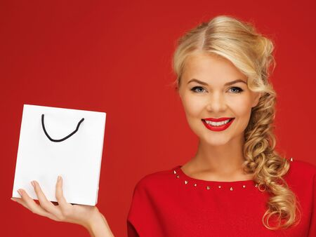 picture of lovely woman in red dress with shopping bag Stock Photo - 16300245