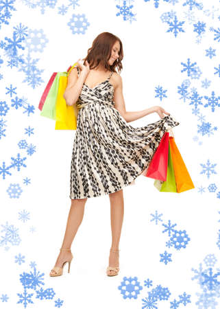 shopaholics: lovely woman with shopping bags over white