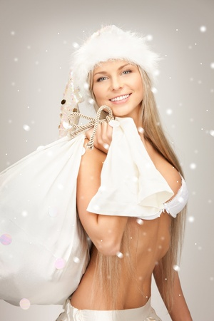 babe: picture of cheerful santa helper girl with big bag