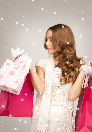 lovely woman with shopping bags over white Stock Photo - 16300305