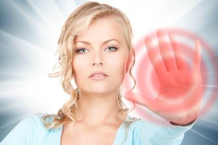 bright picture of young woman making stop gesture Stock Photo